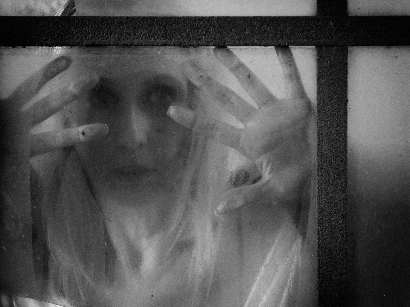 Tears behind the window